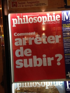 "You've gotta love a country where the news kiosk by the taxi stop advertises a philosophy magazine, right?  ""Subir"" has a bunch meanings related to suffering (probably the intended sense in a philosophy magazine), putting up with, dealing with, undergoing, and enduring."