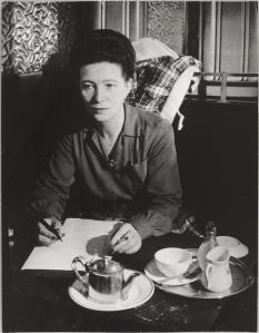 Simone de Beauvoir in an unnamed cafe. Photo source: http://fuckyeahexistentialism.tumblr.com/post/3736286827/simone-de-beauvoir-says-celebrate-international.