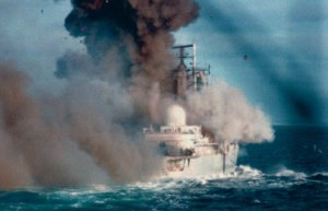 The HMS Coventry takes a missile during the 1982 Falklands war between the United Kingdom and Argentina.  Picture source: http://www.dailymail.co.uk/news/article-2146731/Miranda-Harts-father-relives-terrifying-Falklands-ordeal-30-years-ship-HMS-Coventry-sank-war.html