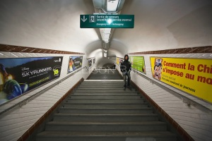Man descending stairs, Abbesses Metro Station, line 12, Paris, France