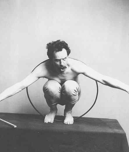 Franz_Boas_-_posing_for_figure_in_USNM_exhibit_entitled_-_Hamats'a_coming_out_of_secret_room_-_1895_or_before